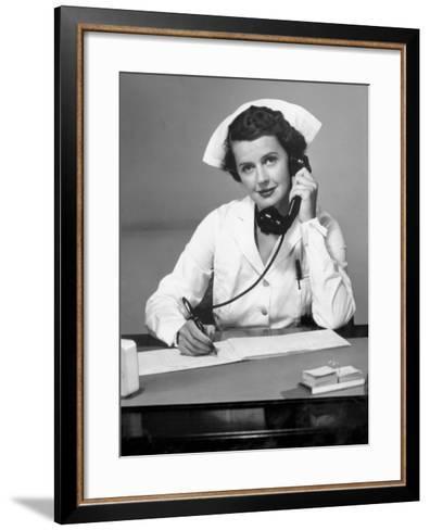 Nurse on the Phone-George Marks-Framed Art Print