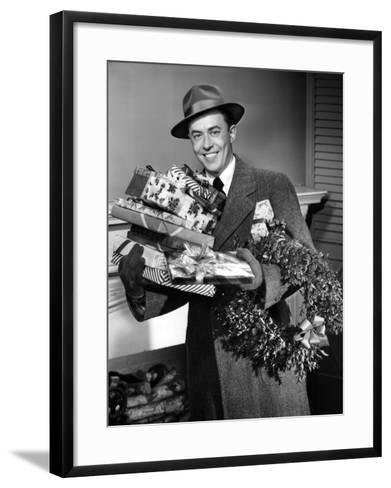 Man With Christmas Gifts-George Marks-Framed Art Print