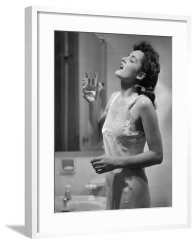 Woman Gargling Water at Bathrom Sink-George Marks-Framed Art Print