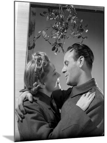 Kiss Under Mistletoe--Mounted Photographic Print