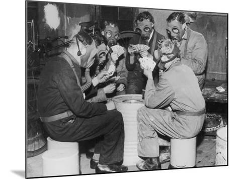 Group of Men Playing Cards, Wearing Gas Masks--Mounted Photographic Print