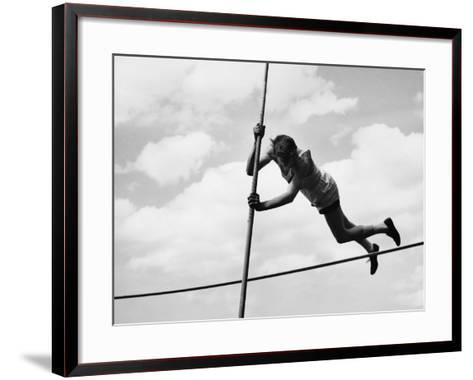 Male Pole-Vaulter Clearing Bar--Framed Art Print