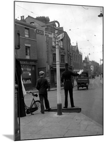 Traffic Cop--Mounted Photographic Print