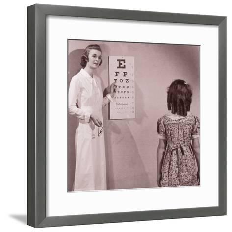 Healthcare Worker Giving Girl (8-10) Eye Examination--Framed Art Print