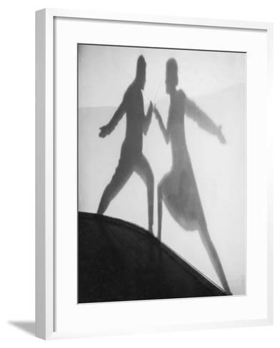 Shadow of Man and Woman Fencing--Framed Art Print
