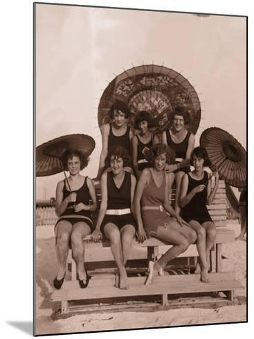 Group of Women in Bathing Suits With Parasols on Bench, 1930's--Mounted Photographic Print