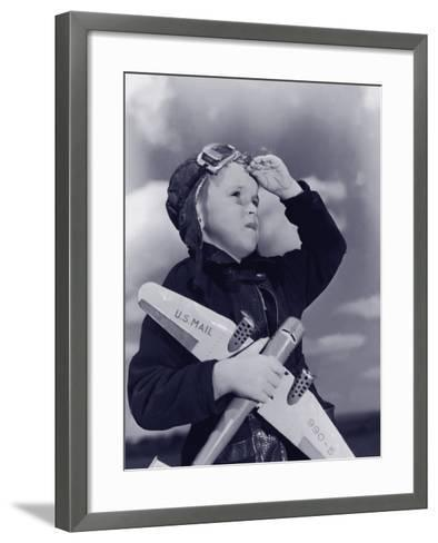 Boy (8-10) Wearing Flying Cap and Goggles Holding Toy Plane--Framed Art Print