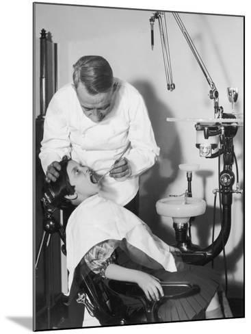 Dentist Examining Girl's Teeth--Mounted Photographic Print