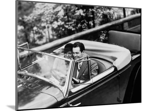 Young Couple in Vintage Soft Top Car With Golf Clubs on Back Seat--Mounted Photographic Print