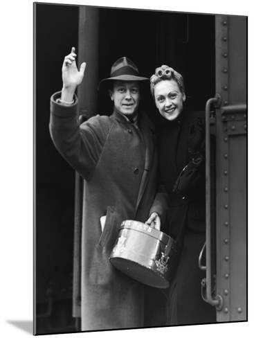 Couple Waving As They Board a Train, Circa 1930's--Mounted Photographic Print