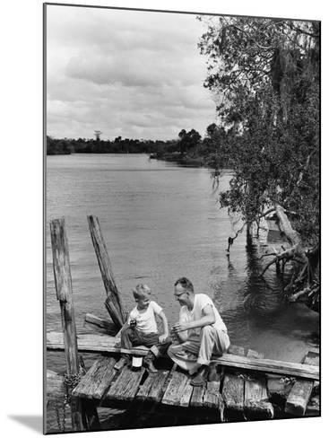 Father and Son Sitting on Dock Getting Ready To Fish--Mounted Photographic Print