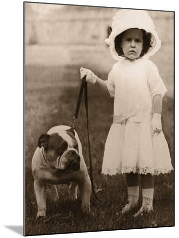 Girl in Dress and Hat, Holding Bulldog on Lead--Mounted Photographic Print