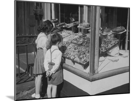 Boy and Girl Looking in at Bakery Window--Mounted Photographic Print