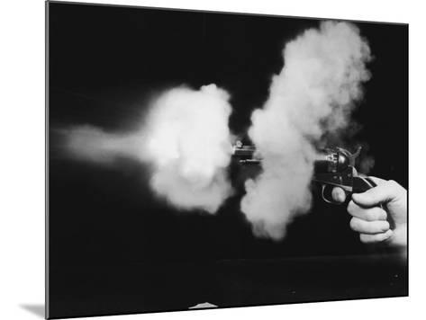 Close-Up of Gun Being Fired--Mounted Photographic Print
