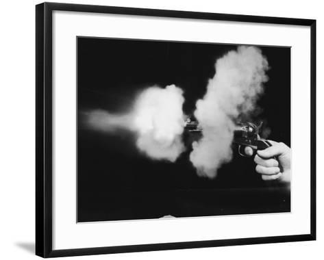 Close-Up of Gun Being Fired--Framed Art Print