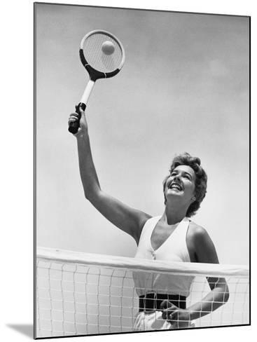 Woman Playing Tennis--Mounted Photographic Print