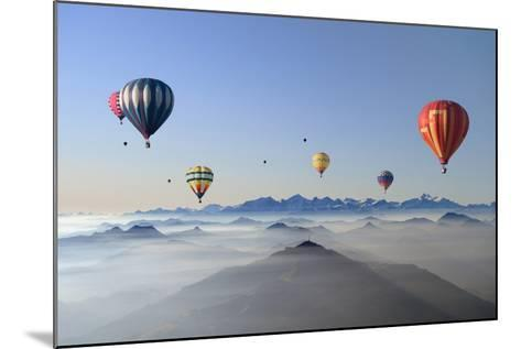 Hot Air Balloons over Mountain Skyline-Axel Lauerer-Mounted Photographic Print