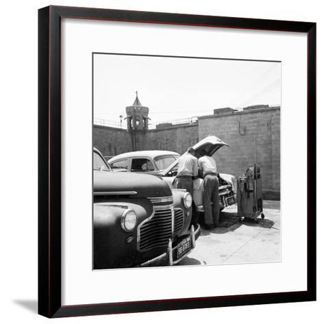 Prison Garage-Three Lions-Framed Art Print