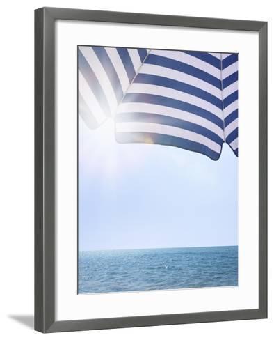 Beach Umbrella and Seascape with Sun Flares-Gregor Schuster-Framed Art Print