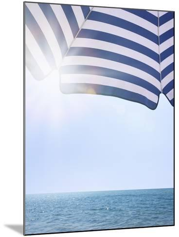 Beach Umbrella and Seascape with Sun Flares-Gregor Schuster-Mounted Photographic Print