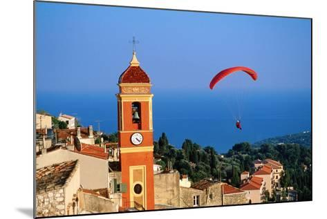 Paraglider Soaring past Tower of Colourful Village Church, Alpes-Maritimes, Roquebrune, Provence-Al-David Tomlinson-Mounted Photographic Print