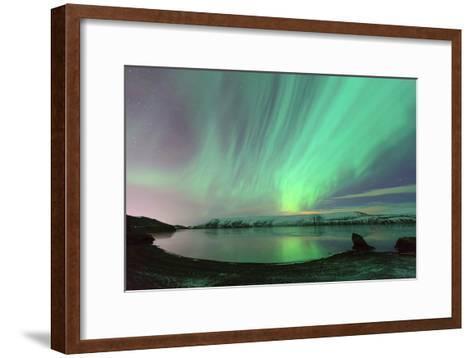 Northern Lights in Iceland-by Chakarin Wattanamongkol-Framed Art Print