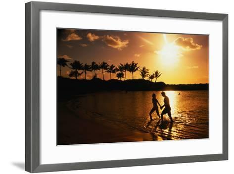 Couple on Beach at Sunset.-Linda Ching-Framed Art Print
