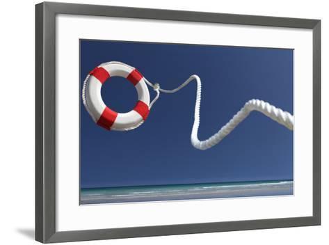 Lifering in Air on Beach-Peter Cade-Framed Art Print