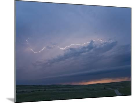 Intracloud Lightning at Sunset from a Thunderstorm in Central Nebraska, USA-Charles Doswell-Mounted Photographic Print