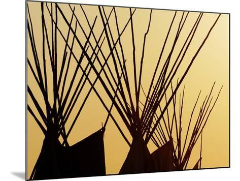 Tops of Tepees Silhouetted at Sunset, Montana-Adam Jones-Mounted Photographic Print