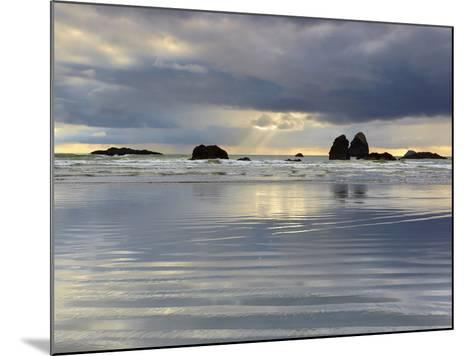 Sunbeams on Cloudy, Stormy Day Behind the Sandy Beach and Offshore Rocks-Patrick Smith-Mounted Photographic Print