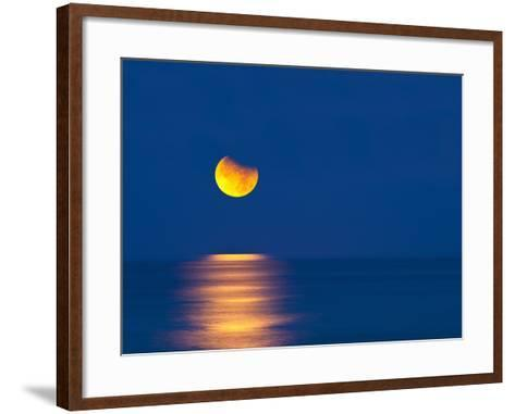 Partial Eclipse of the Moon, Setting over the Gulf of Mexico on the Morning of June 26, 2010-David Nunuk-Framed Art Print