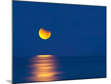 Partial Eclipse of the Moon, Setting over the Gulf of Mexico on the Morning of June 26, 2010-David Nunuk-Mounted Photographic Print
