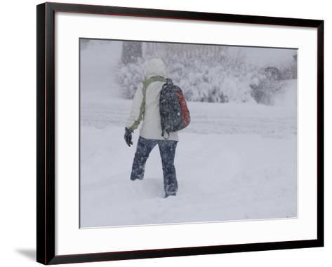 A Pedestrian Walks Through Deep Snow Wearing Cold Weather Clothing During a Winter Storm-Jon Van de Grift-Framed Art Print