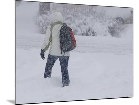 A Pedestrian Walks Through Deep Snow Wearing Cold Weather Clothing During a Winter Storm-Jon Van de Grift-Mounted Photographic Print