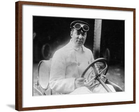 A Man at the Wheel of His Car Dressed in a Driving Coat and Goggles--Framed Art Print