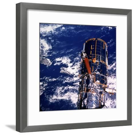 Hubble Space Telescope Above the Earth--Framed Art Print