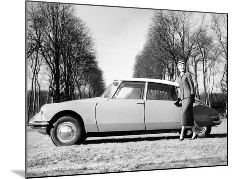 Model with a 1957 Citro?n Id 19, C1957--Mounted Photographic Print