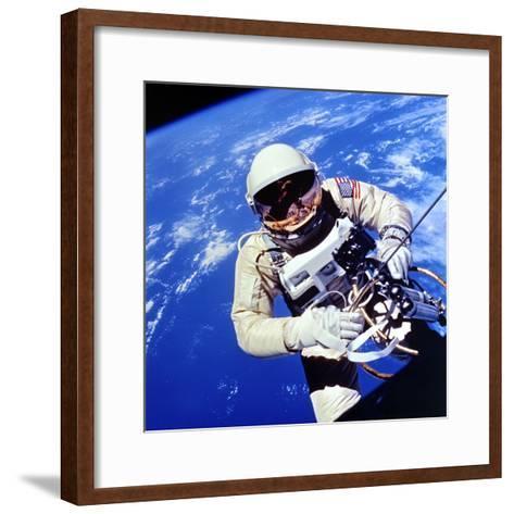 Us Astronaut Edward H. White II Carrying Out External Tasks--Framed Art Print
