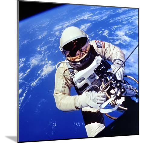 Us Astronaut Edward H. White II Carrying Out External Tasks--Mounted Photographic Print