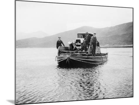 An Early Ferry Transporting a Car across a Lake--Mounted Photographic Print