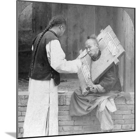 Feeding a Prisoner Wearing a Cangue, China, 1902-CH Graves-Mounted Photographic Print