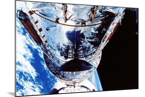 The Hubble Space Telescope Orbiting the Earth, C1990S--Mounted Photographic Print