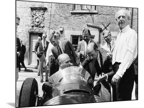 Juan Manuel Fangio at the Wheel of a V16 BRM, 1960s--Mounted Photographic Print
