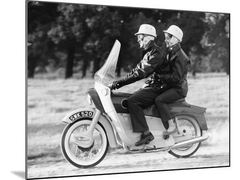 A Man and a Woman Riding an Ariel Leader, 1958--Mounted Photographic Print