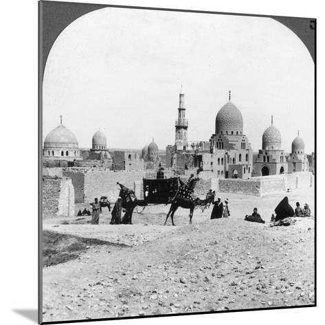 A 'Ship of the Desert' Passing Tombs of By-Gone Moslem Rulers, Cairo, Egypt, 1905-Underwood & Underwood-Mounted Photographic Print