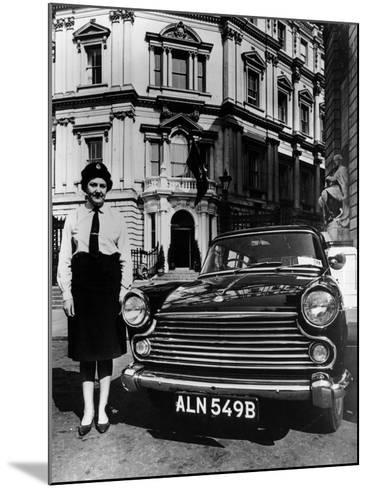 Female Chauffeur Standing by a 1964 Morris Oxford, 1964--Mounted Photographic Print