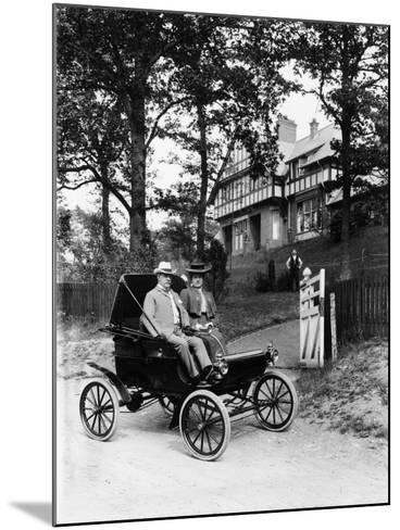 An Oldsmobile Curved Dash, 1902--Mounted Photographic Print