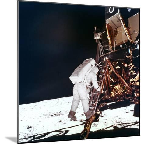 Edwin Buzz Aldrin Descends the Steps of the Lunar Module Ladder to Walk on the Moon, 1969--Mounted Photographic Print