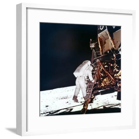 Edwin Buzz Aldrin Descends the Steps of the Lunar Module Ladder to Walk on the Moon, 1969--Framed Art Print
